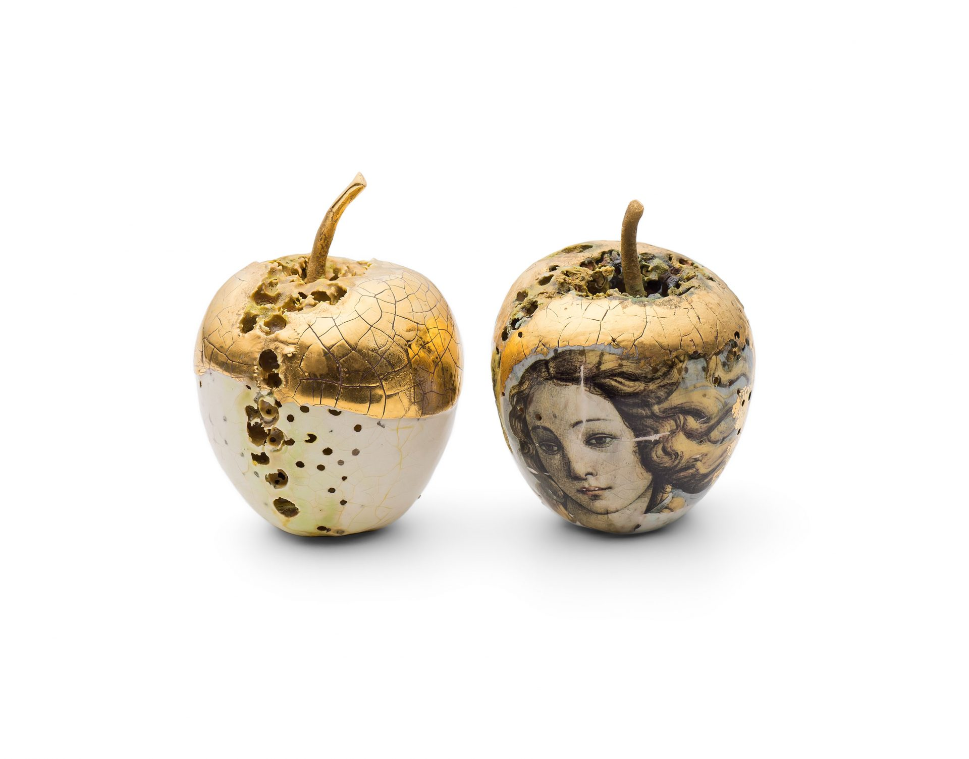 Gold and white ceramic apple by Remon Jephcott