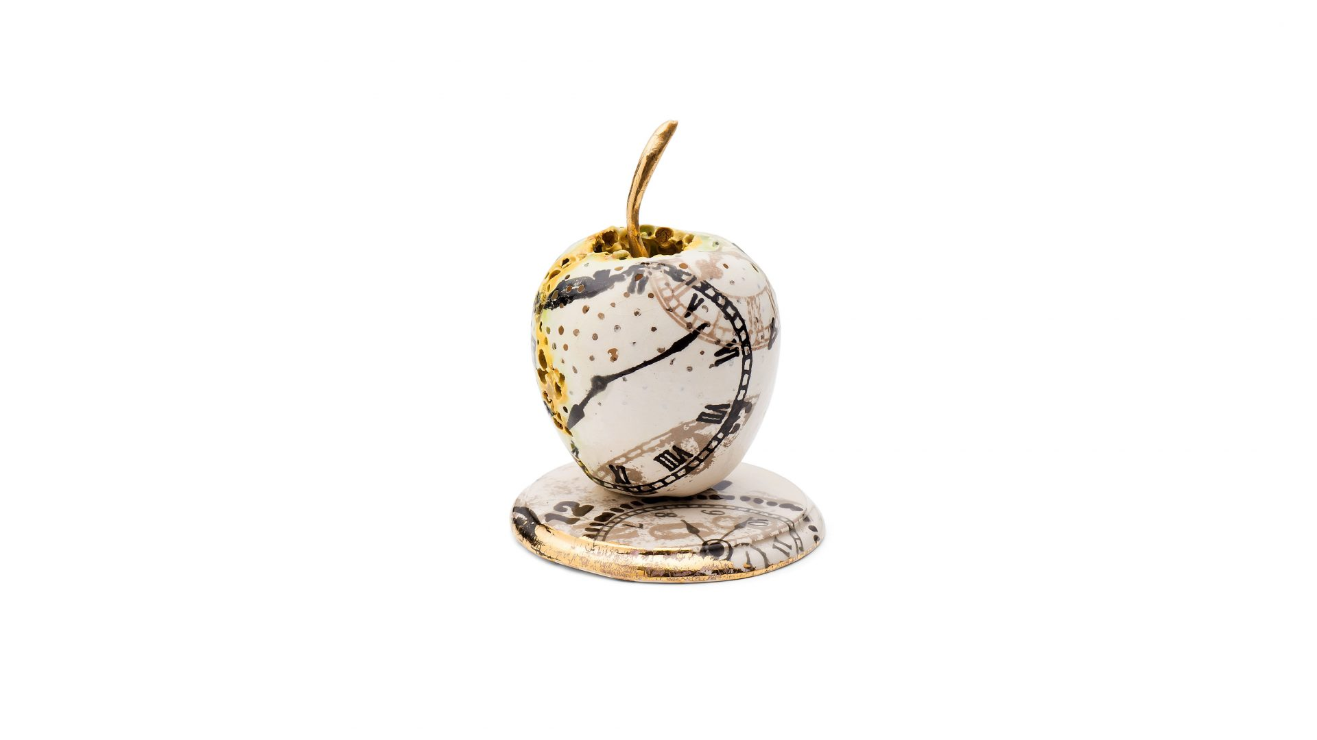 Ceramic white and gold apple by Remon Jephcott